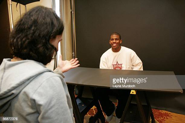 Chris Paul of the New Orleans Hornets chats with NBAE photographer Jennifer Pottheiser during a behind the scenes shoot for 2006 All Star Media...