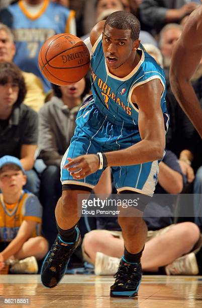 Chris Paul of the New Orleans Hornets controls the ball against the Denver Nuggets in Game One of the Western Conference Quarterfinals during the...