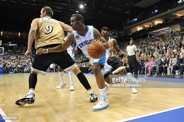 Chris Paul of the New Orleans Hornets dribbles against the Washington Wizards during the 2008 NBA Europe Live Tour on October 14 2008 at the 02 World...