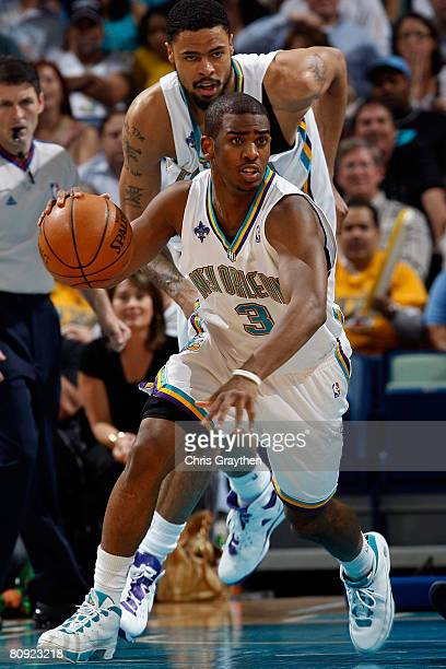 Chris Paul of the New Orleans Hornets drives down the court after stealing the ball from Jason Terry of the Dallas Mavericks in Game Five of the...