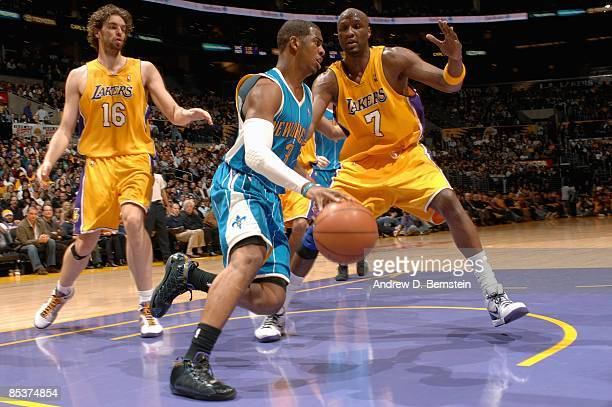 Chris Paul of the New Orleans Hornets drives past Lamar Odom and Pau Gasol of the Los Angeles Lakers during the game on February 20 2009 at Staples...