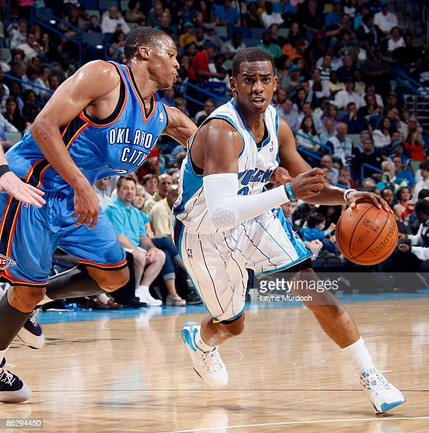 Chris Paul of the New Orleans Hornets drives past Russell Westbrook of the Oklahoma City Thunder on March 7 2009 at the New Orleans Arena in New...