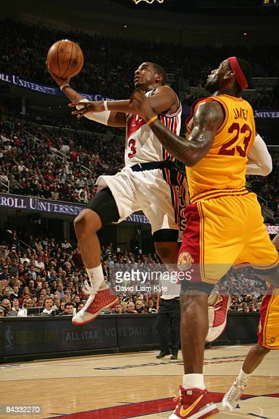 Chris Paul of the New Orleans Hornets glides in for the shot against LeBron James of the Cleveland Cavaliers at The Quicken Loans Arena on January 16...