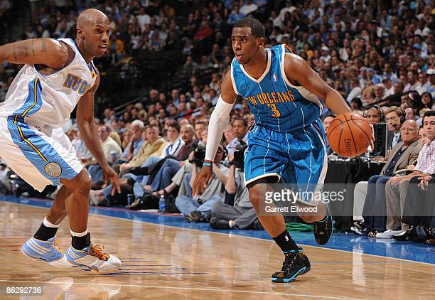 Chris Paul of the New Orleans Hornets goes to the basket against Chauncey Billups of the Denver Nuggets during Game Five of the Western Conference...