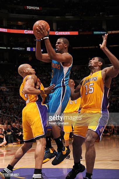 Chris Paul of the New Orleans Hornets goes to the hoop between Derek Fisher and Ron Artest of the Los Angeles Lakers in Game Five of the Western...