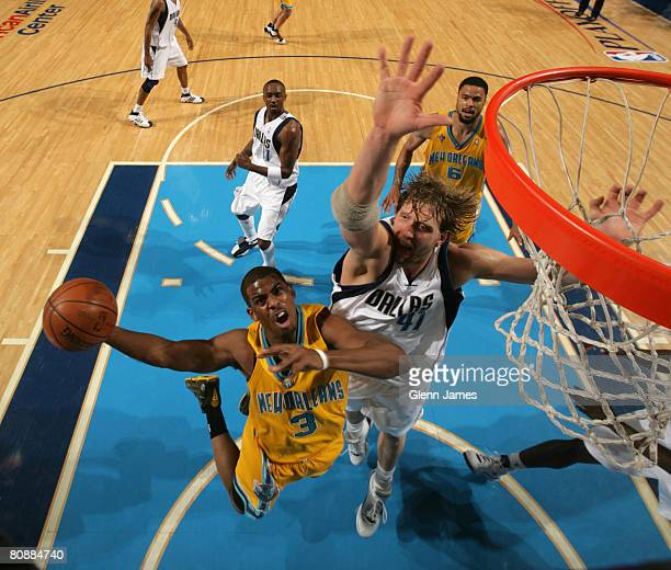 Chris Paul of the New Orleans Hornets goes up for the layup against Dirk Nowitzki of the Dallas Mavericks in Game Four of the Western Conference...