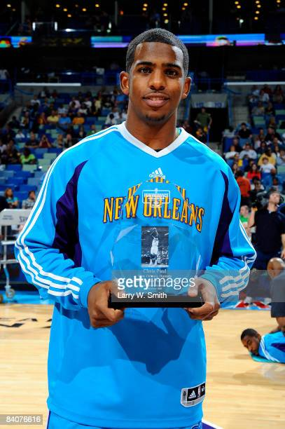 Chris Paul of the New Orleans Hornets holds the Western Conference Player of the Month Award presented by Kia Motors before the Hornets' game against...