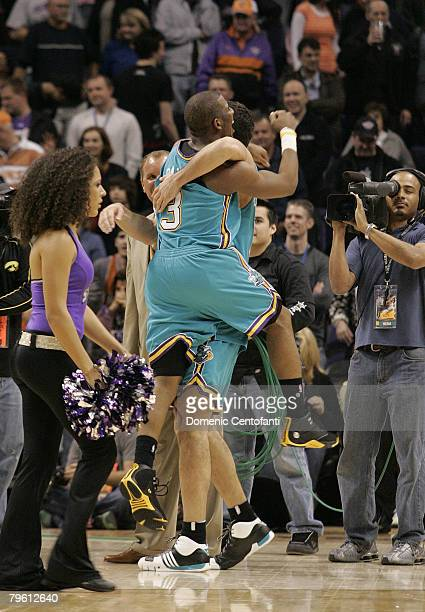 Chris Paul of the New Orleans Hornets leaps into the arms of teammate Peja Stojakovic after Stojakovic hit the gamewinning shot to beat the Phoenix...