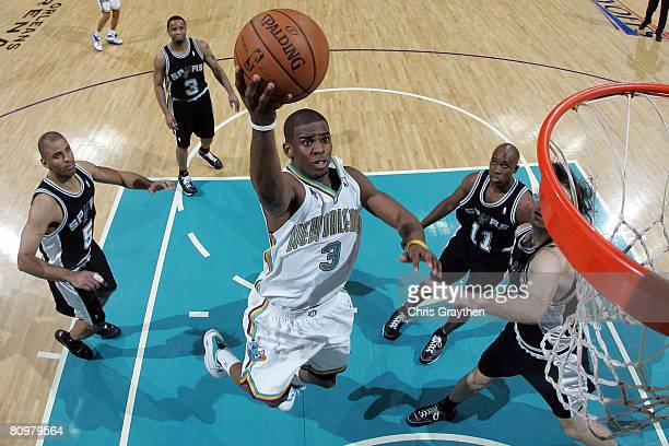 Chris Paul of the New Orleans Hornets makes a shot over Fabricio Oberto of the San Antonio Spurs in Game One of the Western Conference Semifinals...