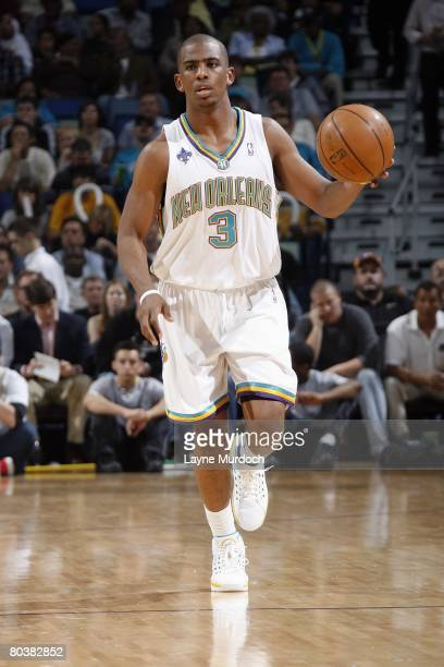 Chris Paul of the New Orleans Hornets moves the ball during the NBA game against the Houston Rockets at the New Orleans Arena on February 22 2008 in...