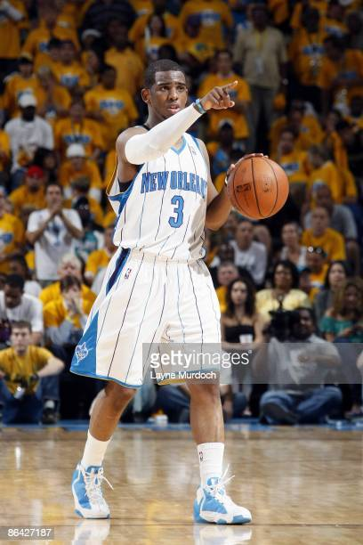 Chris Paul of the New Orleans Hornets moves the ball up court against the Denver Nuggets in Game Three of the Western Conference Quarterfinals during...