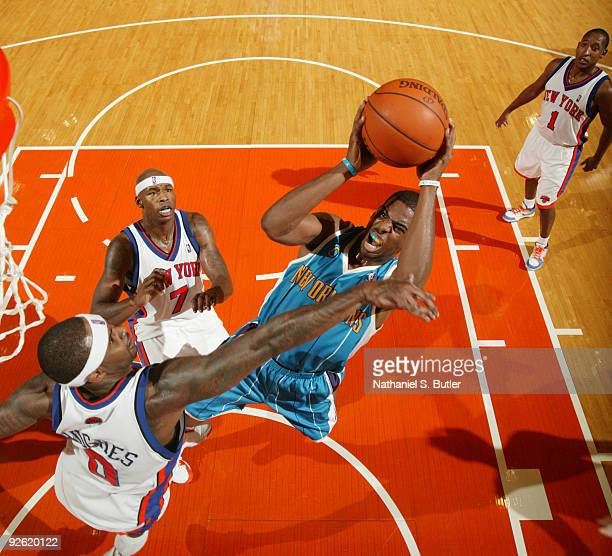 Chris Paul of the New Orleans Hornets shoots against Larry Hughes of the New York Knicks on November 2 2009 at Madison Square Garden in New York City...