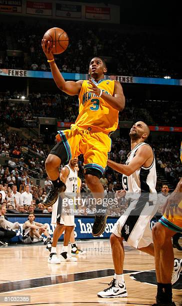 Chris Paul of the New Orleans Hornets shoots against Tony Parker of the San Antonio Spurs in Game Three of the Western Conference Semifinals during...