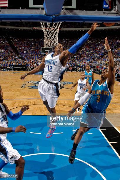 Chris Paul of the New Orleans Hornets shoots as Dwight Howard of the Orlando Magic attempts to block his shot during the game on December 25 2008 at...