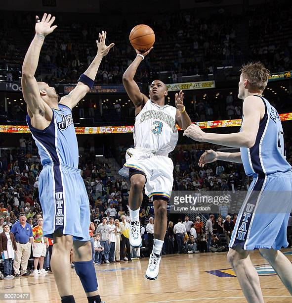 Chris Paul of the New Orleans Hornets shoots over Carlos Boozer and Andrei Kirilenko of the Utah Jazz on February 29 2008 at the New Orleans Arena in...