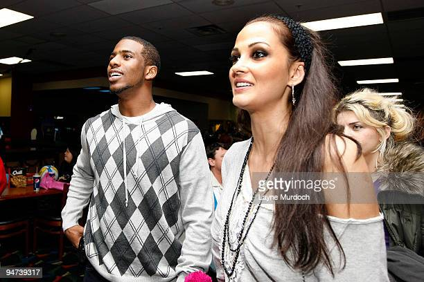 Chris Paul of the New Orleans Hornets stands beside Peja Stojakovic's wife Aleka Kamila as Peja hosts his third annual Charitabowl celebrity bowling...
