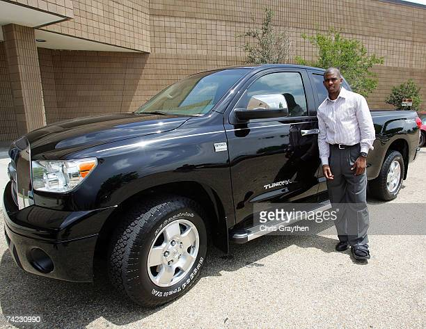 Chris Paul of the New Orleans Hornets stands next to a new Toyota Tundra truck at the unveiling of a new basketball court at Sarah T Reed High School...