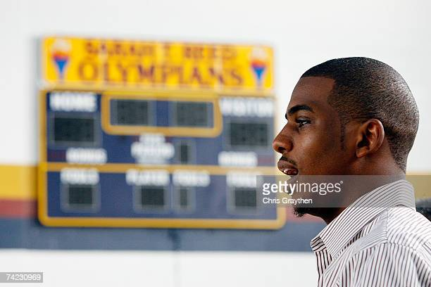 Chris Paul of the New Orleans Hornets talks to students at the unveiling of a new basketball court at Sarah T Reed High School as part of the Toyota...