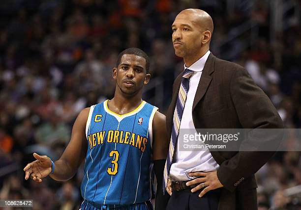 Chris Paul of the New Orleans Hornets talks with head coach Monty Williams during the NBA game against the Phoenix Suns at US Airways Center on...