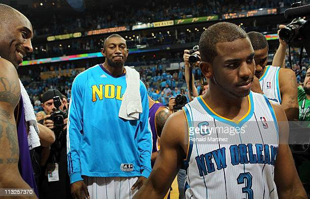 Chris Paul of the New Orleans Hornets walks off the court after a 9880 loss as Kobe Bryant of the Los Angeles Lakers smiles after winning the series...