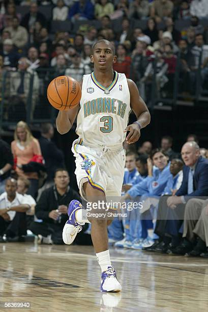 Chris Paul of the New Orleans/Oklahoma City Hornets brings the ball upcourt during the game against the Denver Nuggets at the Ford Center on November...
