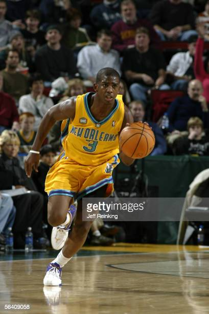 Chris Paul of the New Orleans/Oklahoma City Hornets brings the ball up court against the Seattle SuperSonics November 26 2005 at Key Arena in Seattle...