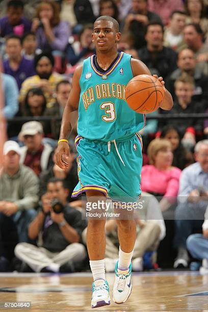 Chris Paul of the New Orleans/Oklahoma City Hornets brings the ball up court against the Sacramento Kings on April 16 2006 at ARCO Arena in...