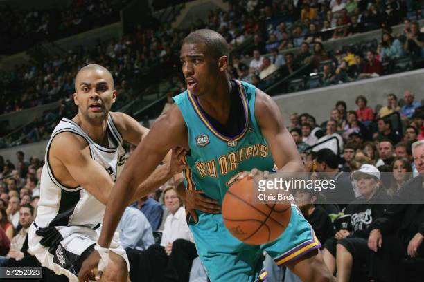 Chris Paul of the New Orleans/Oklahoma City Hornets dribbles against Tony Parker of the San Antonio Spurs during the game at ATT Center on March 14...