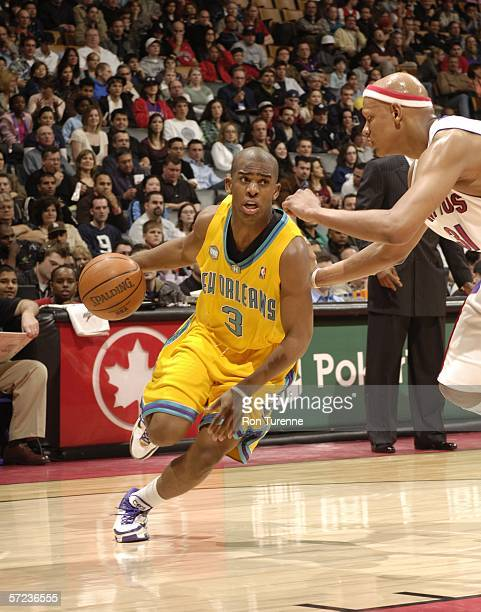 Chris Paul of the New Orleans/Oklahoma City Hornets drives in against Charlie Villanueva of the Toronto Raptors on April 2 2006 at the Air Canada...