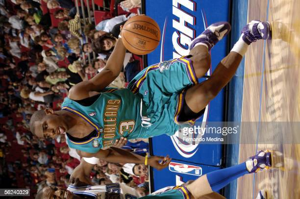Chris Paul of the New Orleans/Oklahoma City Hornets drives to the basket against Steve Francis of the Orlando Magic November 19 2005 at TD Waterhouse...