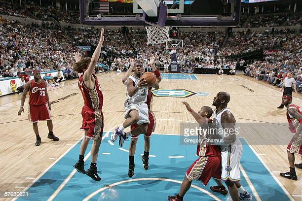 Chris Paul of the New Orleans/Oklahoma City Hornets goes to the basket against Anderson Varejao of the Cleveland Cavaliers during the game at the...