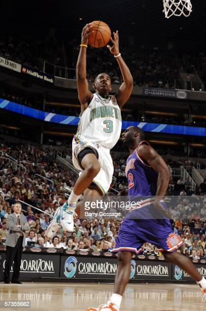 Chris Paul of the New Orleans/Oklahoma City Hornets goes up for a layup on a turnover against the Phoenix Suns in NBA action April 17 at US Airways...