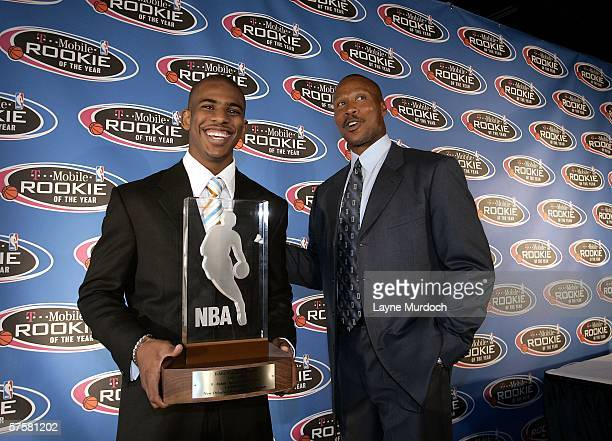Chris Paul of the New Orleans/Oklahoma City Hornets holds the Eddie Gottlieb Trophy alongside head coach Byron Scott after being named the 2006 NBA...