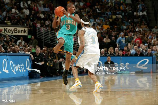 Chris Paul of the New Orleans/Oklahoma City Hornets looks to pass against Allen Iverson of the Denver Nuggets at the Pepsi Center on March 6 2007 in...