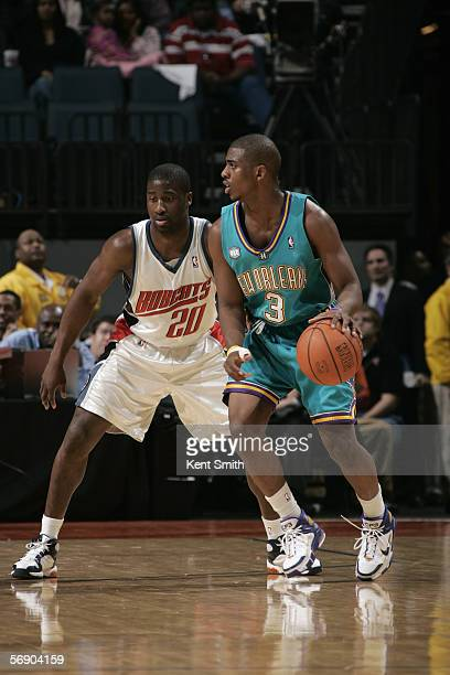 Chris Paul of the New Orleans/Oklahoma City Hornets moves the ball against Raymond Felton of the Charlotte Bobcats during the game January 16 2006 at...