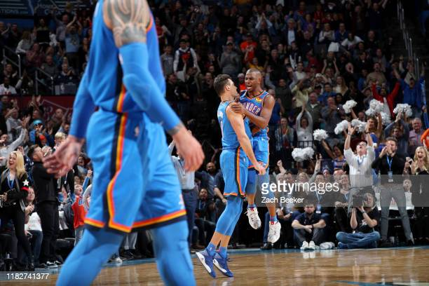 Chris Paul of the Oklahoma City Thunder and Danilo Gallinari of the Oklahoma City Thunder celebrate after a player during a game against the...