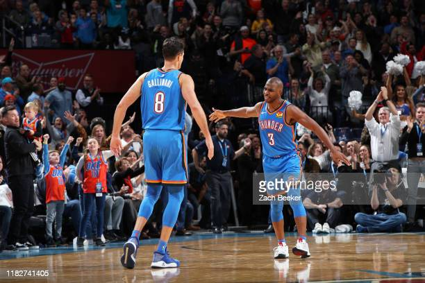 Chris Paul of the Oklahoma City Thunder and Danilo Gallinari of the Oklahoma City Thunder celebrate after a play during a game against the...