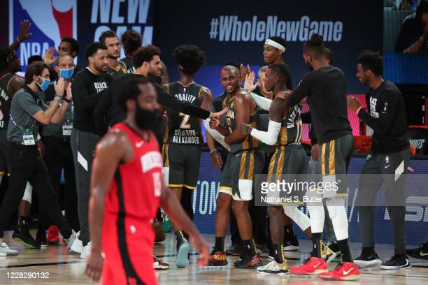 Chris Paul of the Oklahoma City Thunder and the Oklahoma City Thunder react during a game against the Houston Rockets during Round One, Game Six of...