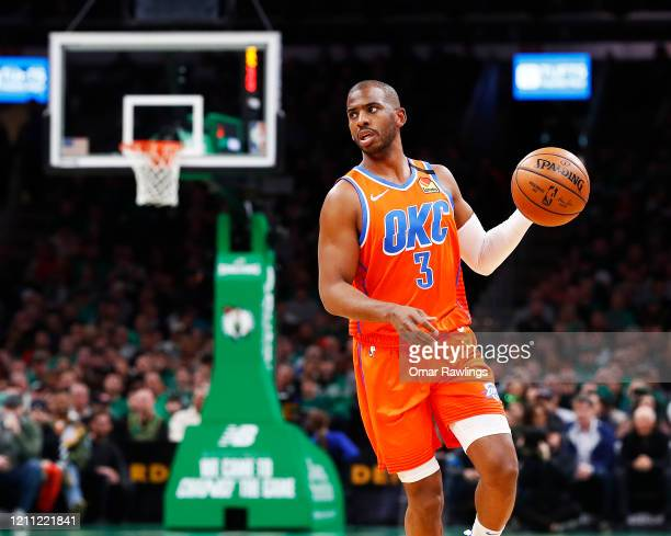 Chris Paul of the Oklahoma City Thunder brings the ball up court during the first quarter of the game against the Boston Celtics at TD Garden on...