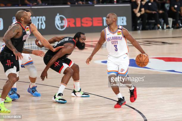 Chris Paul of the Oklahoma City Thunder drives in the game against the Houston Rockets for Game seven of the first round of the 2020 Playoffs as part...
