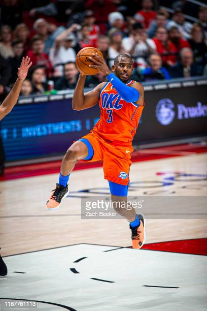 Chris Paul of the Oklahoma City Thunder drives to the basket and passes the ball against the Portland Trail Blazers on December 8, 2019 at Moda...