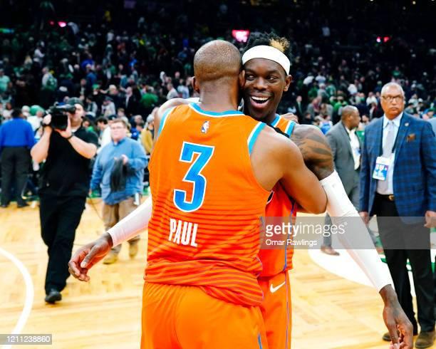 Chris Paul of the Oklahoma City Thunder embraces Dennis Schroder of the Oklahoma City Thunder after the victory over the Boston Celtics at TD Garden...