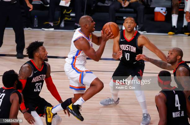 Chris Paul of the Oklahoma City Thunder goes up for a shot against the Houston Rockets during the second quarter in Game Four of the Western...
