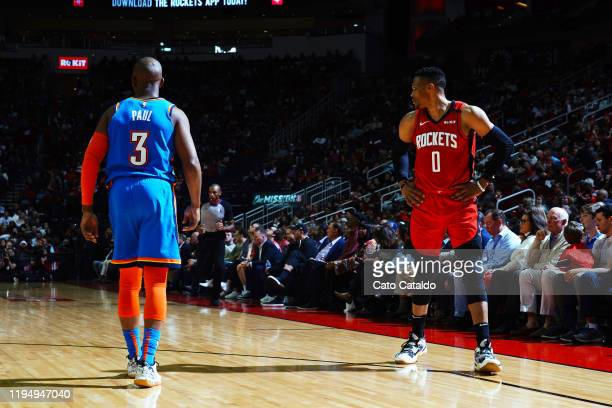 Chris Paul of the Oklahoma City Thunder guards Russell Westbrook of the Houston Rockets during the game on January 20, 2020 at the Toyota Center in...
