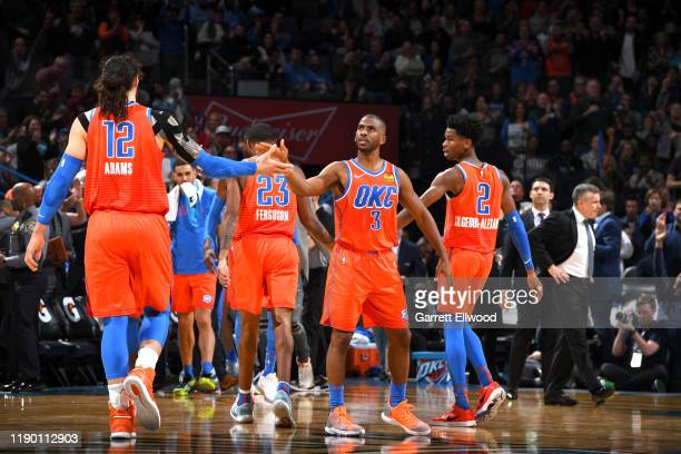 Chris Paul of the Oklahoma City Thunder high fives teammate Steven Adams of the Oklahoma City Thunder during a game against the LA Clippers on...