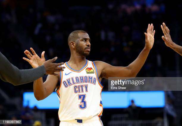 Chris Paul of the Oklahoma City Thunder is congratulated by Nerlens Noel and Terrance Ferguson after they beat the Golden State Warriors at Chase...
