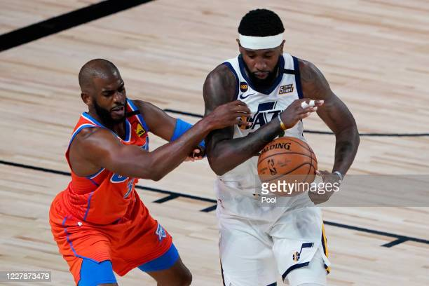 Chris Paul of the Oklahoma City Thunder, left, guards Royce O'Neale of the Utah Jazz during the first half of an NBA basketball game on August 1 in...