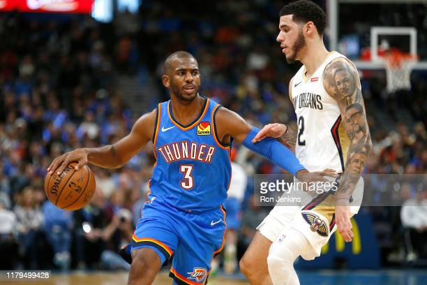 Chris Paul of the Oklahoma City Thunder of the Oklahoma City Thunder looks past Lonzo Ball of the New Orleans Pelicans during the first half at...
