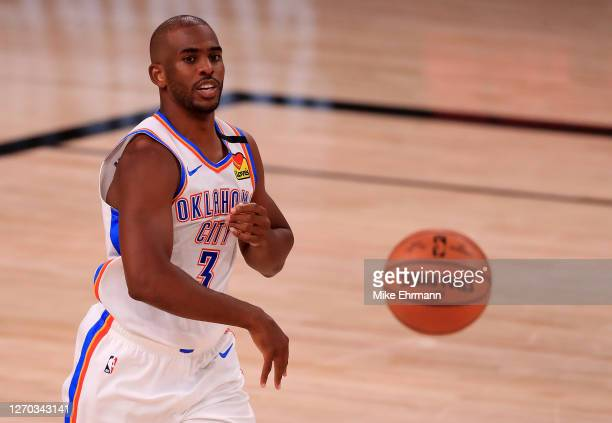 Chris Paul of the Oklahoma City Thunder passes the ball during the second quarter against the Houston Rockets in Game Seven of the Western Conference...