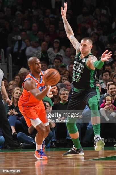 Chris Paul of the Oklahoma City Thunder passes the ball while Daniel Theis of the Boston Celtics plays defense during the game on March 8 2020 at the...